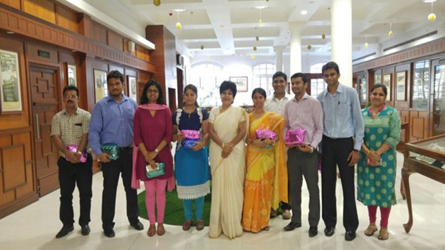 Director [HR&CA] along with winners of Environment Day competitions. LED bulbs were distributed as prizes.